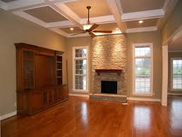 synthetic wood flooring for living room with fireplace and windows