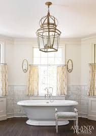 master bathroom with freestanding soaking tub and white marble