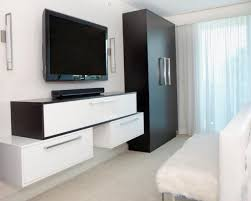 bedroom with white wooden media wall using storage drawer bench
