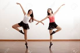 pretty hispanic ballet dancers practicing a routine in a dance
