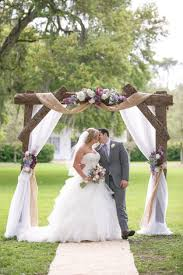 Davids Bridal Bride Lauren Chose An Oleg Cassini Gown For Her Rustic Vintage Wedding I Love Dress And The Wood Arch
