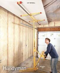Hanging Drywall On Ceiling Trusses by Garage Remodel Tips Family Handyman