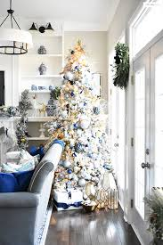 FLOCKED CHRISTMAS TREE WITH NAVY LIGHT BLUE SILVER AND GOLD