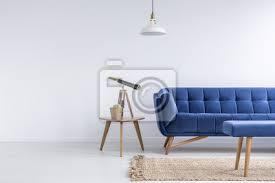 fototapete helle wohnung mit blauem sofa