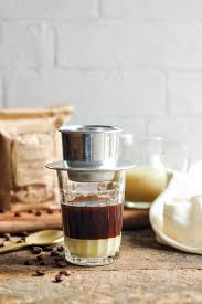 Vietnamese Coffee Filter On Glass With Condensed Milk