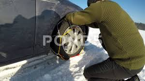 A Man Fitting Snow Chains. ~ Hi Res Video #71964276
