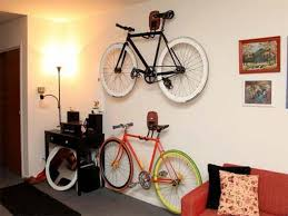 Ceiling Bike Rack For Garage by Interior Brown Wooden Bike Racks Hanging On Cream Painted Wall