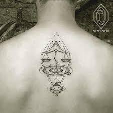Unique Libra Zodiac Tattoo Design On Back For Men
