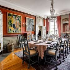 Ornate Medium Tone Wood Floor And Orange Enclosed Dining Room Photo In Stockholm With A