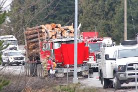 Logging Truck Catches Fire On Highway Near Parksville - Parksville ... Michigan Upper Peninsula Logging Truck Stock Photos Photo By Jeremy Rempel Highways Today Bob Cat Removing Logs From Overturned On Highway Farwell Canyon Near Williams Lake British Columbia Eatonville To Rainier Thrwheel Ford Nt950 Old Peterbilt Logging Truck With 10 Wide Bunks Pinterest This Electric Driverless Can Carry Up 16 Tons Of Fileb Double In Australiajpg Wikimedia Commons Allectric And Autonomous Unveiled Electrek Loses Load Mayook The Drive Fm Loading A On Location Youtube