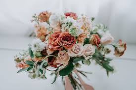 Named For Their Signature Arrangements Of Posies In A Bucket Full Roses Is Wedding Stylist As Well Creator Bespoke Bridal Bouquets And