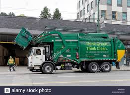 Green Clean Energy Waste Management Garbage Truck Lifting A Dumpster ...