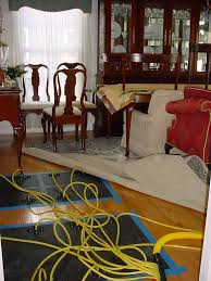 Buckled Wood Floor Water by Hardwood Floor Drying Water Damaged Wood Floors Water Damage Blog