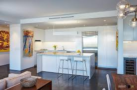Minimalist Whie Kitchen Design With Breakfast Space Along Cozy Living Room Big Sofa Aside The Dining Area Also Fantastic Lights