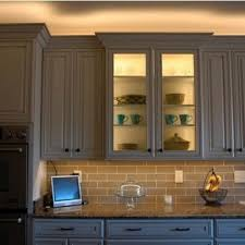 led lighting above cabinet and inside glass cabinet undercabinet