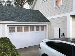 elon musk unveils solar panels resembling traditional roofing