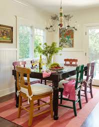 old painted chairs and table give the shabby chic dining room