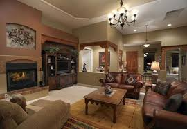 Ace Vintage Ideas For Living Room With Iron Chandelier Over Barn Table Feat Brown Leather Sofa As Well Antique Cabinetry Decorating Designs