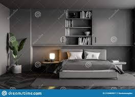 graues schlafzimmer mit bett und leinen bücherregal und