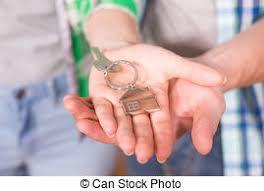 Holding House Keys On Shaped Keychain