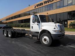 100 2012 Trucks International 4400 Tandem Axle Cab Chassis Truck DT 285HP