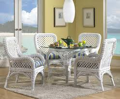 Charming Painted White Rattan Dining Room Chairs With Glass Topped Wicker Table In A Yellow Coastal Area Rug