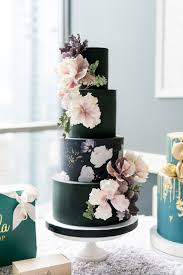 Black Four Tiered Wedding Cake with Flowers