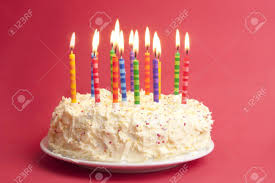birthday cake with lots of candles on a red background Stock