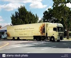 Oversized Dutch Flower Lorry Delivering Flowers In Small Village Surrey England