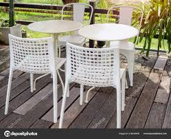 White Modern Mixed Match Tables Chairs Old Wooden Floor ...