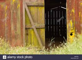 Closeup Of A Weathered Old Red Barn With Open Door Stock Photo ... 11 Best Garage Doors Images On Pinterest Doors Garage Door Open Barn Stock Photo Image Of Retro Barrier Livestock Catchy Door Background Photo Of Bedroom Design Title Hinged Style Doorsbarn Wallbed Wallbeds N More Mfsamuel Finally Posting My Barn Doors With A Twist At The End Endearing 60 Inspiration Bifold Replace Your Laundry Pantry Or Closet Best 25 Farmhouse Tracks And Rails Ideas Hayloft North View With Dropped Down Espresso 3 Panel Beige Walls Window From Old Hdr Creme
