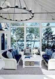Lake Muskoka Cottage With Coastal Interiors Sunroom White Wicker Furniture Nautical Themed Pillows And Beautiful View Of Natural Surroundings