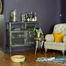 First Grab A Corner Of The Living Room And Paint It In Dark Moody Hue Add Salvaged Industrial Cabinet An Upcycled Armchair