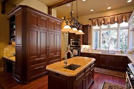 Favored Traditional Kitchen Ideas Added Small Island With Sink White Marble Top Under Classic Pendant Lights Also Brown Wooden Cabinets On