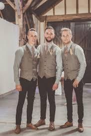 Groom And Groomsmen Wear Tweed Waistcoats Black Jeans For An Informal Rustic Wedding