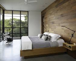 Example Of A Minimalist Concrete Floor And Gray Bedroom Design In Austin