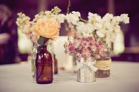 Homemade Cheap Wedding Reception Decorations With Flowers In Small Bottles On Round Table