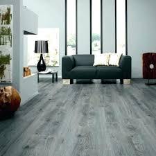 Dark Wood Laminate Texture Flooring Vinyl Sheet In The Kitchen