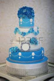 e large beautiful delicious many tier decorated wedding cake white and blue colours with flower
