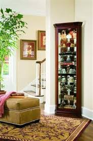 chocolate cherry finished corner curio pulaski 20852 curio by