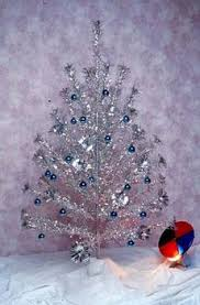 Silver Tin Foil Christmas Tree With A Rotating Color Wheel For Reflections