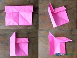 Fold The Top One Fourth Portion Of Paper Down To Middle Crease While Pulling Upper Left Corner Upwards Side