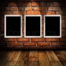 Empty Frames In A Room Against Brick Wall