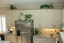 And I Wanted Some Color Green Is My Accent The Kids Artwork A Rosemary Topiary Are On Ledge Over Microwave Ovens