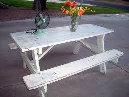 old and vintage portable outdoor wooden picnic table with bench