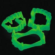 Glow In The Dark Plastic Pumpkins by Amazon Com Fun Express Glow In The Dark Vampire Fangs 1 Pack