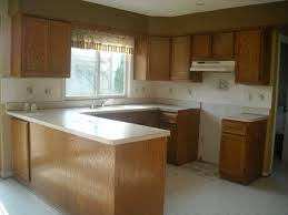 Kitchen Backsplash With Oak Cabinets by White Subway Tile Backsplash African Mahogany Wood Cabinets Light