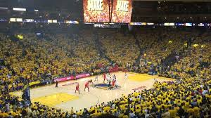 Golden Yellow Shirts Dominate Oracle Arena During Game 5 Of The 2015 Western Conference Finals Between