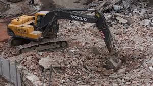 Demolition Of An Old Building. Excavator Filling A Truck With Rubble ...