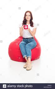 Happy Girl With Cup Of Coffee Sitting In Red Bean Bag Chair ... The Coffee Time Style Bean Bag Chair Garden Camping Beanbag Cover Lazy Sofa Anywhere Portable Sitting Cushionin Living Room Chairs From Fniture On 2017 New Hot Sale Modern Leather Set L Armchair With Coffee Bag Chair Round Table Outdoor Cover West Elm Canada Pallet Ottoman Biggie Bags Xl Size Cream Empty New Premium Soft Replica Tolix In Gunmetal Cushion Cafe Chevron Sack 5 Ft Multiple Colors Rustic Pig A French Feed Refinished Diy Fufsack Wide Wale Corduroy 7foot Xxl